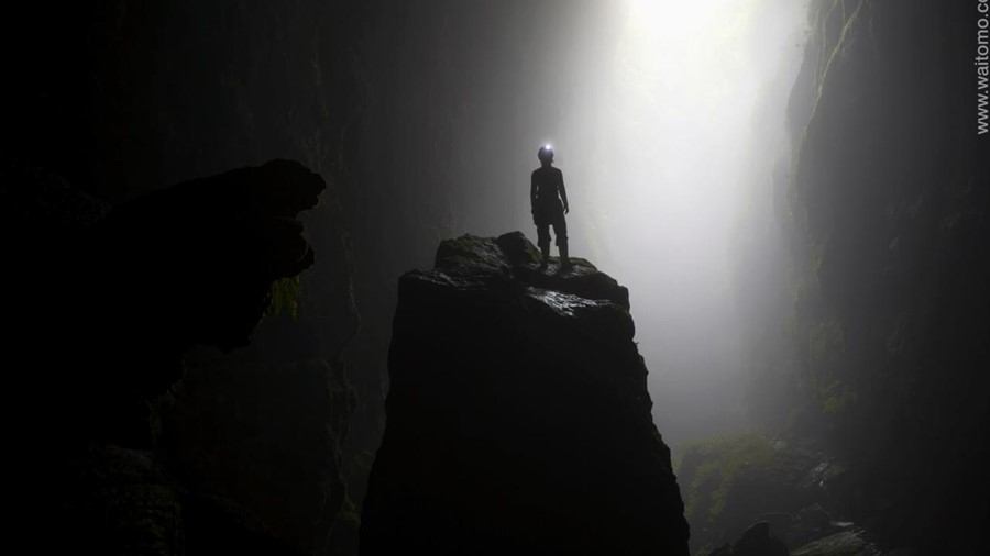 "Waitomo Caves. New Zealand.  100 metre abseil (rappel) into ""Lost World"" underground cave system. Model release # 495"